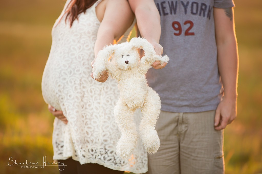 Parents-to-be hold up baby's bunny - Pregnancy Portaiture Mornington Peninsula
