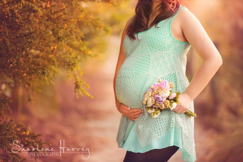 Pregnant mother holding flowers - Sharlene Harvey Photography