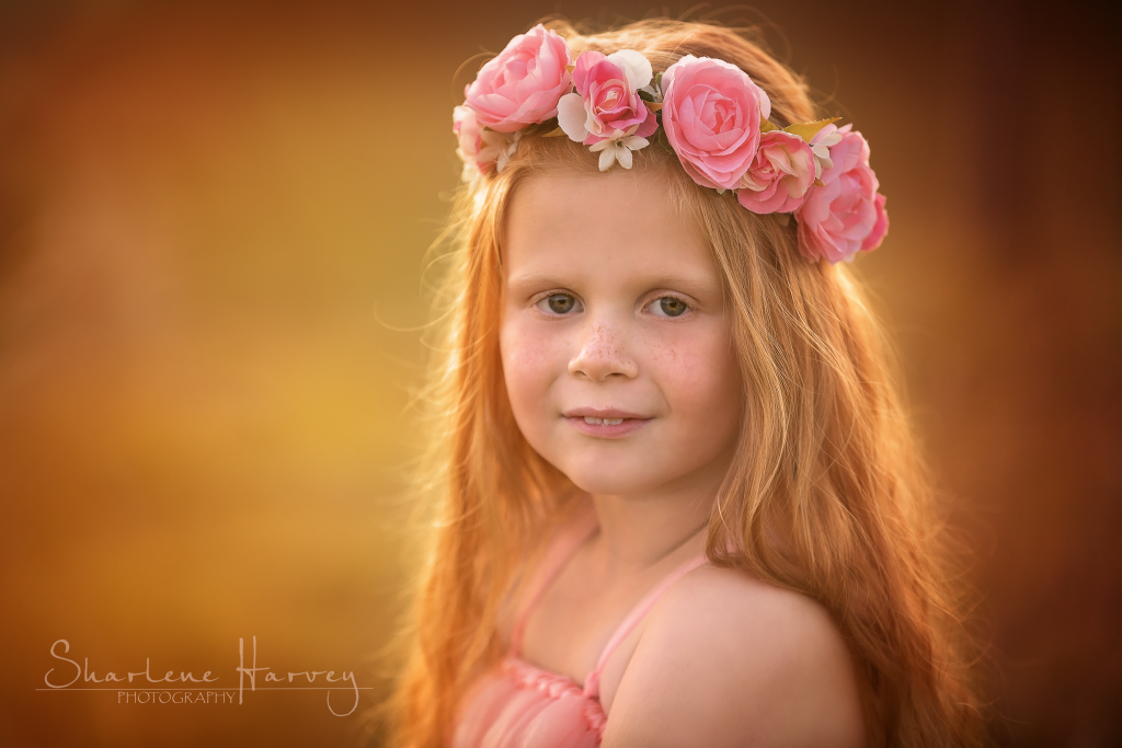 Gorgeous redheaded girl in backlit sunset