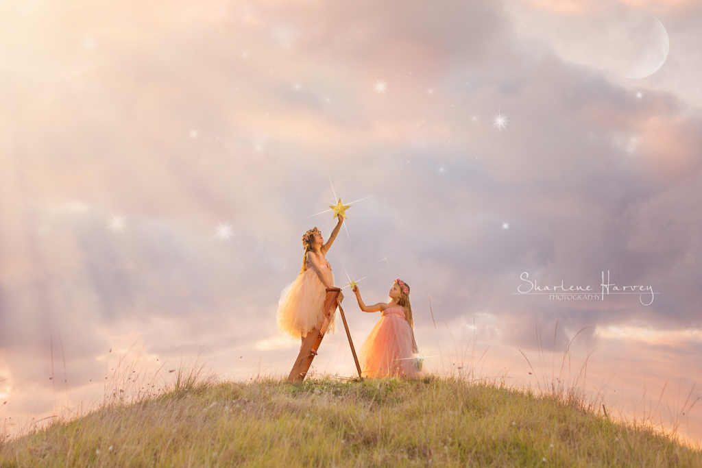 Gorgeous girls in tulle dresses putting stars back into the sky